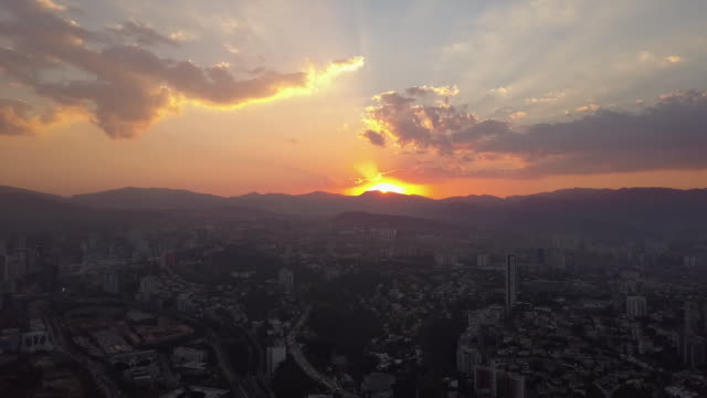 Sunset over Mexico City skyline, wide aerial