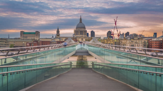 sunset over millennium bridge and st paul's cathedral in london. - london millennium footbridge stock videos & royalty-free footage
