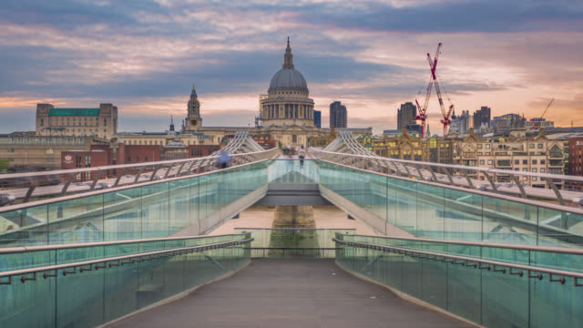 Sunset over Millennium Bridge and St Paul's Cathedral in London.