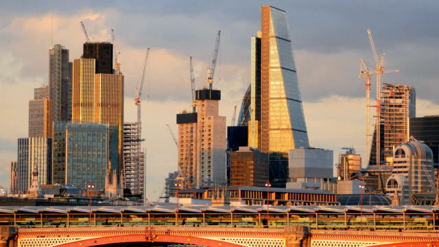 sunset over modern skyscrapers and thames river in london - london bridge england stock videos and b-roll footage