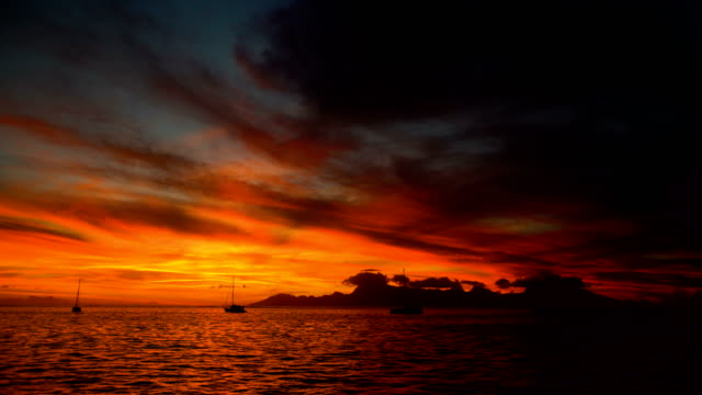 Sunset over Moorea Island from Tahiti South Pacific