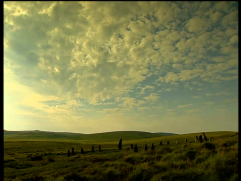 sunset over moorland menhirs and megaliths silhouetted on horizon dartmoor - dartmoor stock videos & royalty-free footage