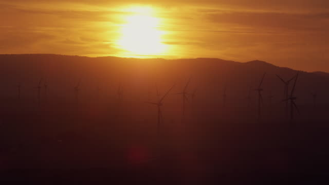 WS Sunset over mountain and silhouetted wind park / Cadiz, Spain