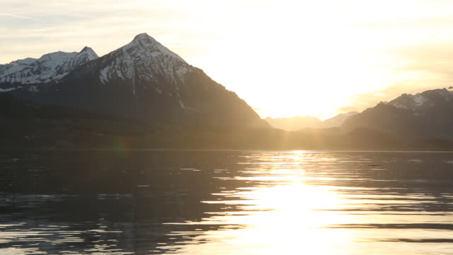Sunset over mountain lake, springtime