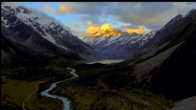 sunset over mountain peak aerial view - new zealand southern alps stock videos & royalty-free footage