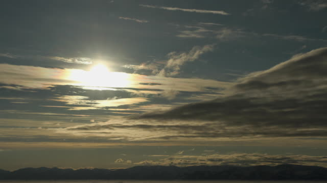 t/l ws sunset over mountains/ pond inlet, nunavut, canada - nu stock videos & royalty-free footage