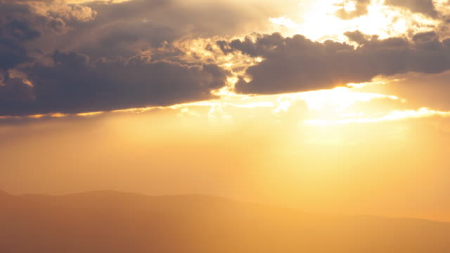 sunset over mountains - light beam stock videos & royalty-free footage