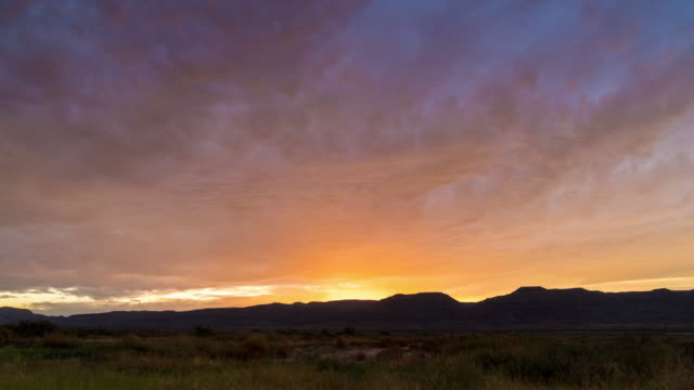 sunset over mountains - southwest usa video stock e b–roll