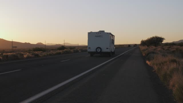sunset over north 93 highway near kingman, arizona, united states of america, north america - kingman arizona stock videos & royalty-free footage