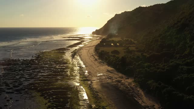 sunset over nyang nyang beach in the bukit peninsula in bali in indonesia - low tide stock videos & royalty-free footage
