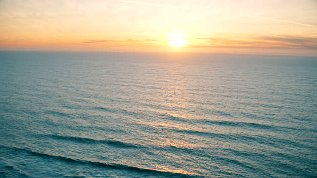 sunset over pacific ocean. aerial views. - bay of water stock videos & royalty-free footage