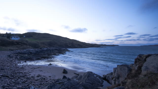sunset over poolewe loch in scotland - tide stock videos & royalty-free footage
