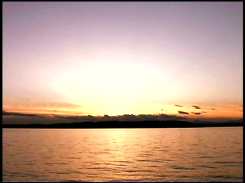sunset over puget sound, washington - puget sound stock videos & royalty-free footage