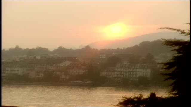sunset over river homes and mountain in montreux switzerland - montreux stock videos and b-roll footage