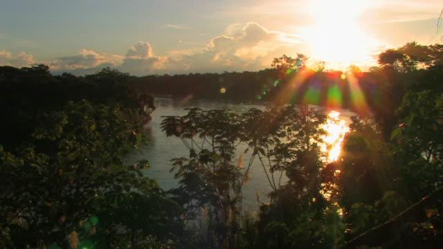 HA WS sunset over river/ Manu National Park, Peru