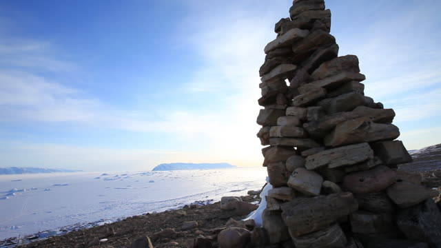 sunset over rock sculpture in greenland tundra, wide - wide stock videos & royalty-free footage