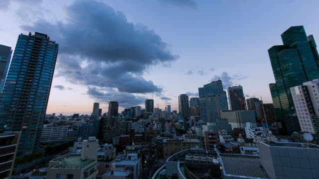 ws t/l sunset over roppongi and akasaka business and residential districts / tokyo, japan - dusk to night stock videos & royalty-free footage