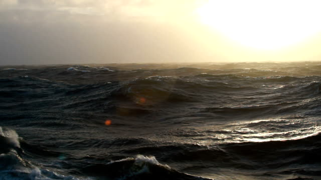sunset over rough seas - rough stock videos and b-roll footage