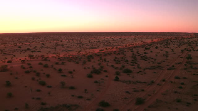 sunset over sand dunes of the kalahari desert - namibia stock videos & royalty-free footage