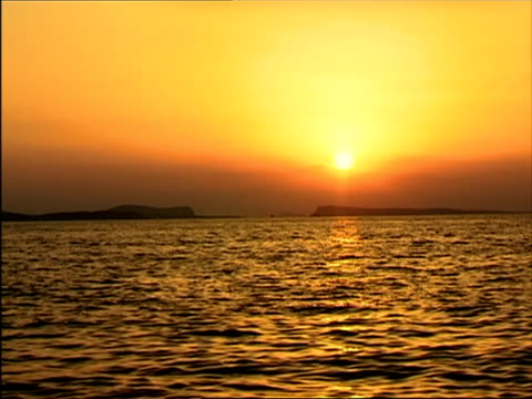ws, sunset over sea, san antonio bay, ibiza, spain - stationary process plate stock videos and b-roll footage