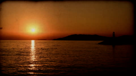 sunset over sea / stop motion video - 8mm film projector stock videos & royalty-free footage