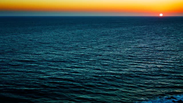 sunset over sea - light at the end of the tunnel stock videos & royalty-free footage
