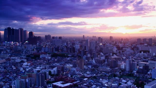 t/l ws ha sunset over shinjuku and shin-okubo areas, dusk to night transition, tokyo, japan - office block exterior stock videos & royalty-free footage