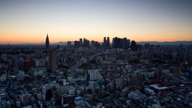 WS T/L Sunset over Shinjuku business, shopping and entertainment district / Tokyo, Japan