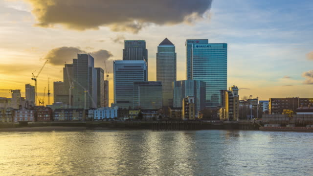 sunset over skyscrapers in london's docklands. - canary wharf stock videos & royalty-free footage