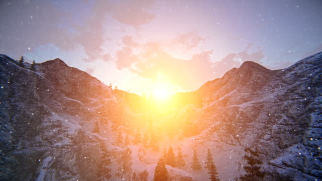 Sunset over snowy mountain ridge