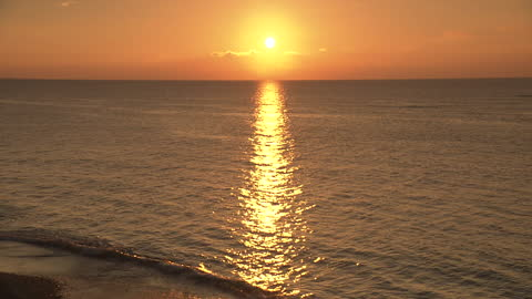 sunset over sparkling ocean, okinawa, japan - seascape stock videos & royalty-free footage