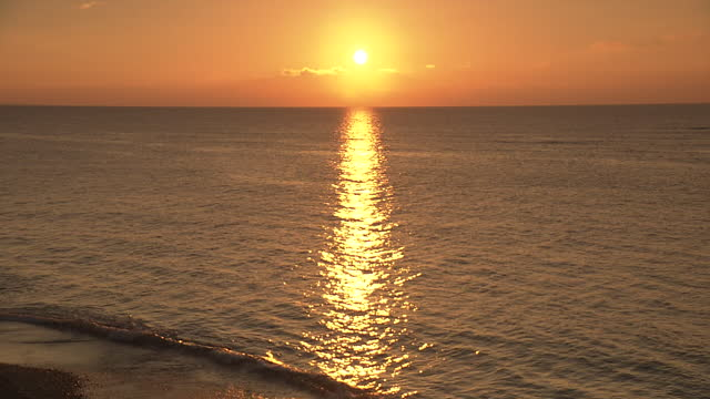 sunset over sparkling ocean, okinawa, japan - dramatic sky stock videos & royalty-free footage