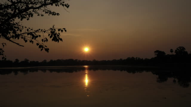 sunset over srah srang lake - cambodia stock videos and b-roll footage