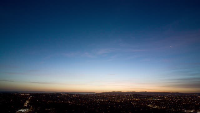t/l, ws, ha, sunset over suburb of mount eden, day to night, auckland, new zealand - day to night time lapse stock videos & royalty-free footage