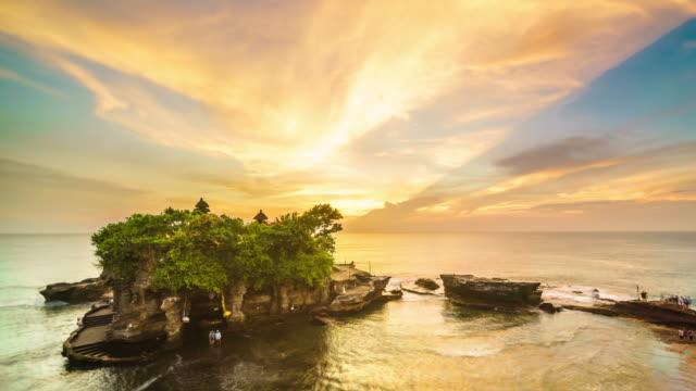Sunset over Tanah Lot temple Bali Indonesia time lapse 4k
