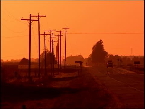 sunset over telegraph poles nebraska - telegraph machine stock videos & royalty-free footage