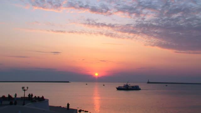 sunset over the bay of sevastopol - sevastopol crimea stock videos and b-roll footage