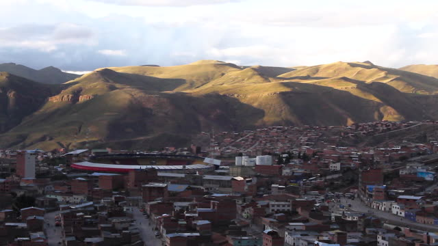 sunset over the city of potosi with football stadium/ bolivia - bolivien stock-videos und b-roll-filmmaterial