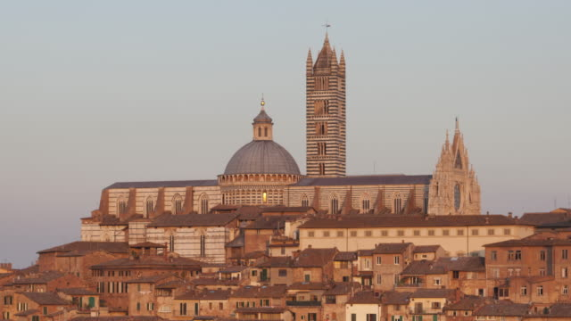 sunset over the city of siena, italy. - torre del mangia stock videos and b-roll footage