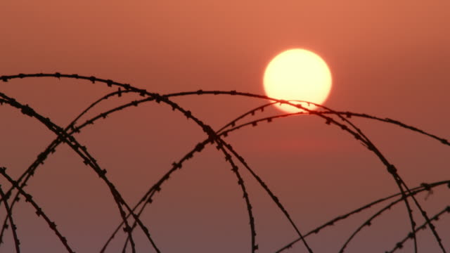 sunset over the east sea near a military fence/ dmz (demilitarized zone between south and north korea), goseong-gun - wire mesh fence stock videos & royalty-free footage