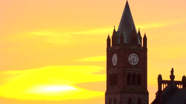 Sunset over the Guildhall in Derry the city town hall