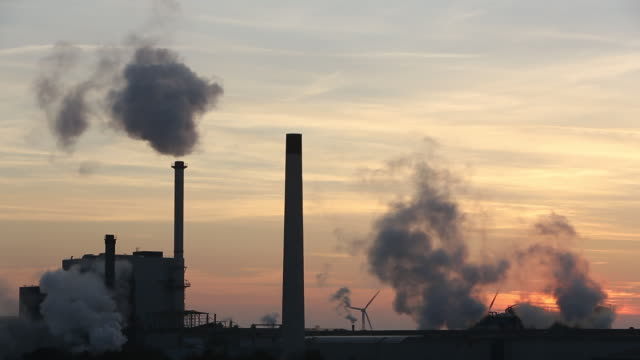 sunset over the iggesund paper board manufacturer  - dämmerung stock-videos und b-roll-filmmaterial