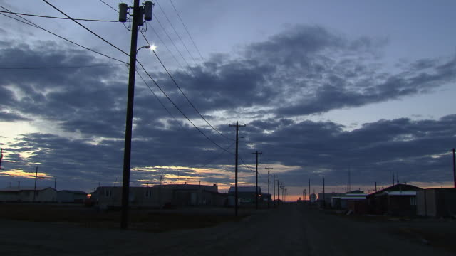 sunset over the inupiat city of kaktovik in alaska.  - power line stock videos & royalty-free footage