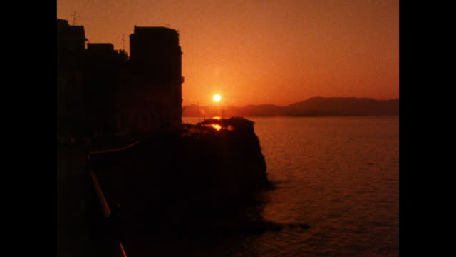 sunset over the ionian sea from corfu town; 1986 - greece stock videos & royalty-free footage