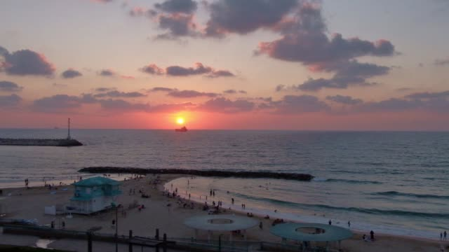 sunset over the mediterranean sea across bar kochba beach in the southern city of ashkelon in israel - ashkelon stock videos and b-roll footage