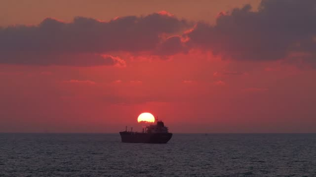 stockvideo's en b-roll-footage met sunset over the mediterranean sea across blue rose chemical/oil tanker built in china sailing off shore in israel - china east asia