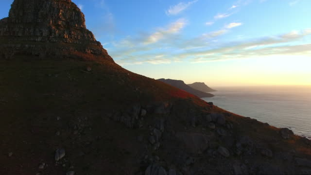 sunset over the mountain - lion's head mountain stock videos and b-roll footage