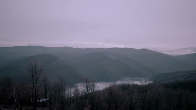 sunset over the mountains in the fog - transilvania video stock e b–roll