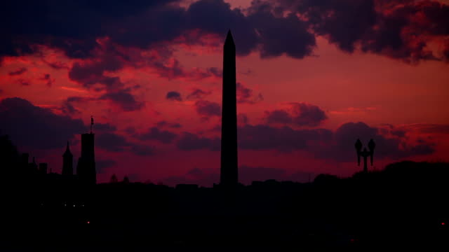 sunset over the national mall with washington monument - the castle stock videos and b-roll footage