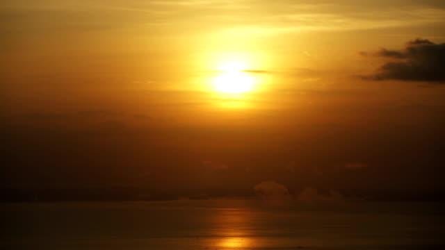 Sunset over the ocean. Timelapse
